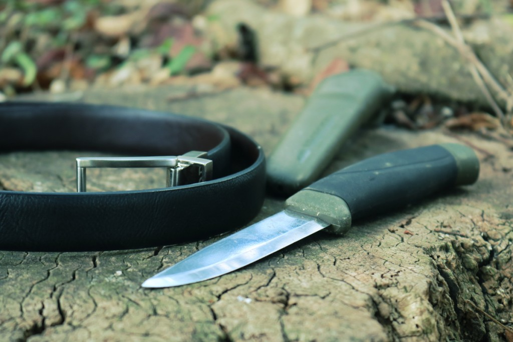 a dull knife with a leather belt