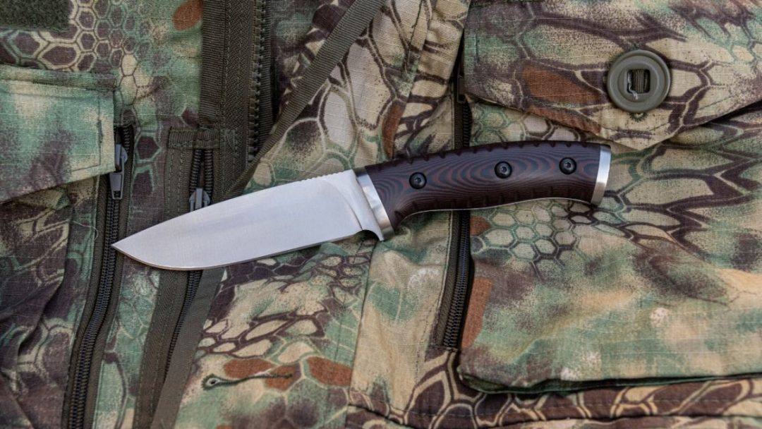 photo of a skinning knife on camo