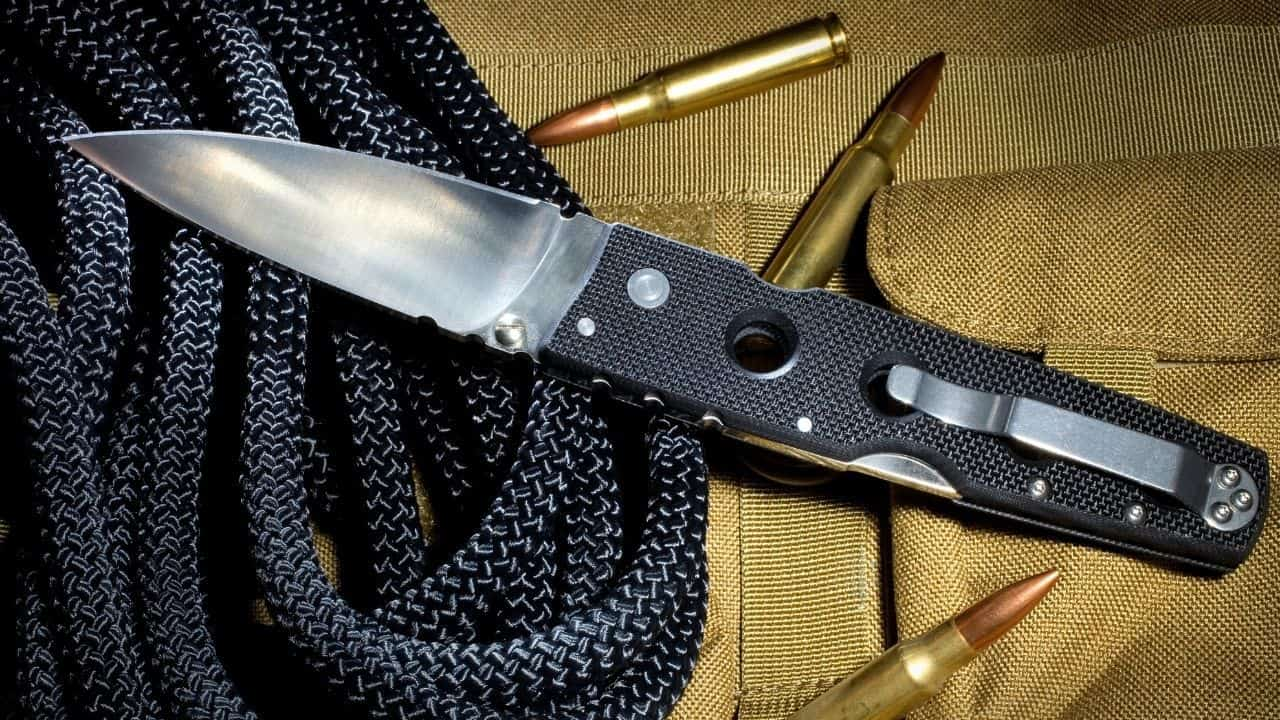 photo of a black folding knife with holes in its handle